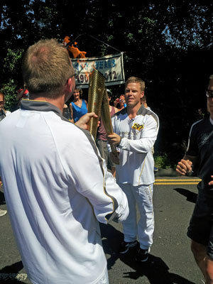 Saku Koivu gets his turn with the Olympic torch.