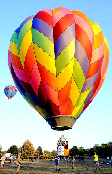 Balloonists take flight during the first hot air balloon festival at Green Grove Gardens near Greencastle, Pa., in this July 31, 2010, file photo.