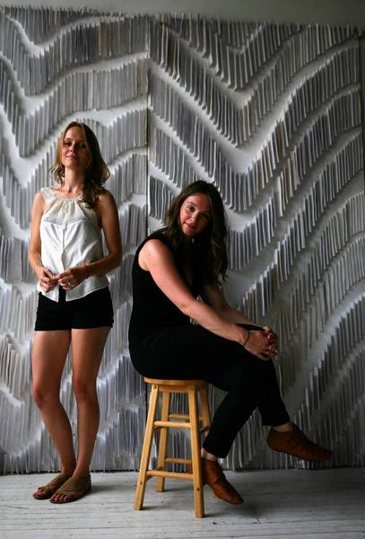 Crystal Grover, left, and Linsey Burritt of Indo in their West Loop workspace.