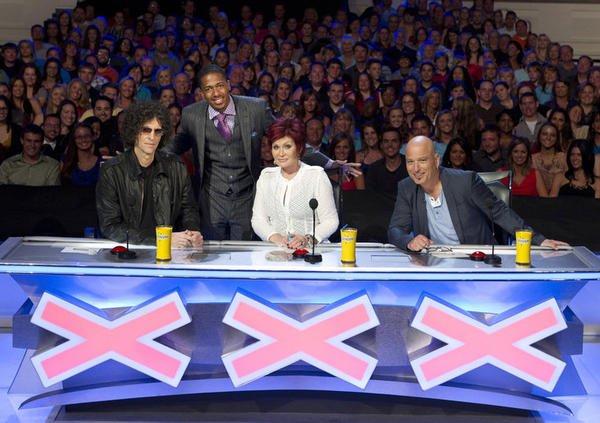 """America's Got Talent"" judge Sharon Osbourne -- with host Nick Cannon, standing, and fellow judges Howard Stern, left, and Howie Mandel -- has tweeted that she is leaving the show."
