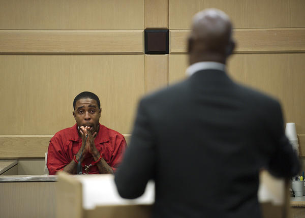 "Kyan Bucknor listens to retired Broward Sheriff's Deputy Alcibiades ""Al"" Hibbert ask for leniency during Bucknor's re-sentencing."
