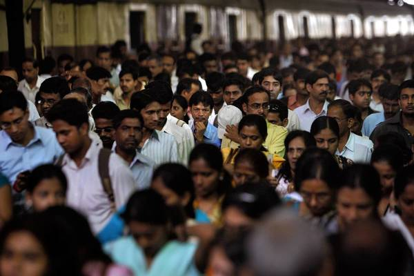 Commuters in Mumbai at the historic Victoria Terminus, one of India's busiest rail station.