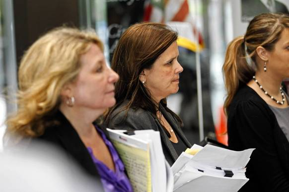 Assistant Public Defender Amy E. Thompson, middle, following the sentencing of William Balfour at the Leighton Criminal Courthouse in Chicago. William Balfour, convicted of killing Oscar-winner Jennifer Hudson's mother, brother and nephew, was sentenced to 3 life sentences.