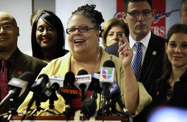 Chicago Teachers Union President Karen Lewis announces Tuesday that the longer school day is being scaled back as a result of contract negotiations with Chicago Public Schools.