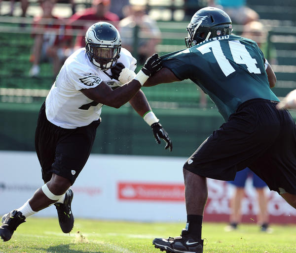Eagles Vinny Curry is held off by D. J. Jones (right) during practice Tuesday afternoon. Philadelphia Eagles rookies and selected vets practice at Lehigh University training camp Tuesday.