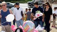 Photos: Christian Bale visits Colorado shooting victims