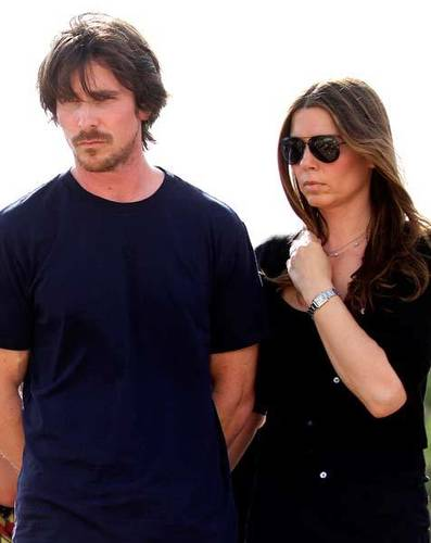 Christian Bale and his wife Sandra Blazic visit the memorial across the street from the Century 16 movie theater July 24, 2012 in Aurora, Colo.