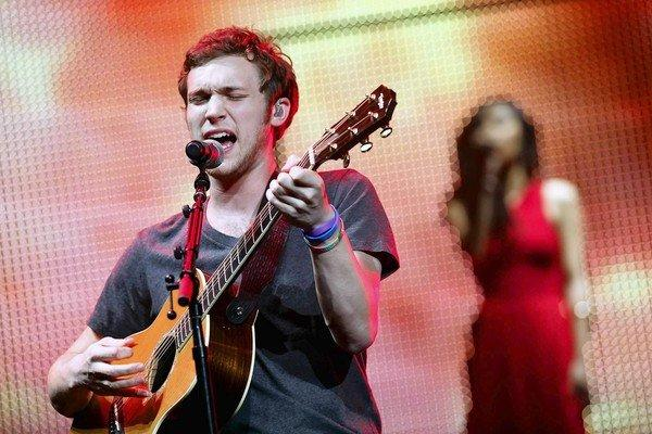 Phillip Phillips, winner of Season 11, performs with runner-up Jessica Sanchez, as part of the Idols Live tour.