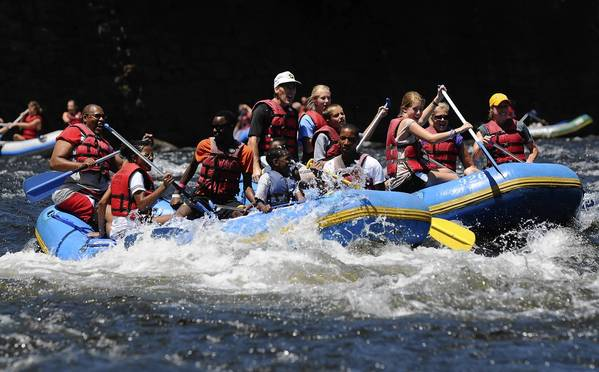 Tourists have been flocking from all over the country to white water raft in Jim Thorpe. Here families enjoy a raft trip down through the Lehigh Gorge Thursday July 5, 2012.