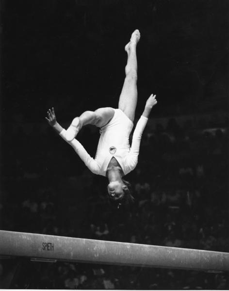 Romania's Nadia Comaneci performs on the balance beam during the 1976 Summer Olympics in Montreal. She won the gold medal in the all-around competition.