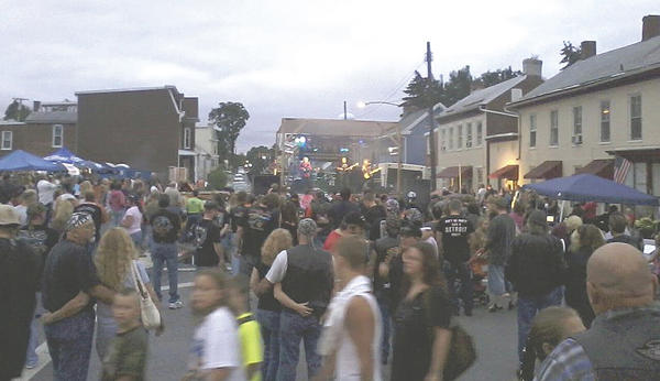 The band Great Train Robbery drew a crowd to the stage as the group rocked out at the fifth annual Williamsport Bike Nite on Saturday night.