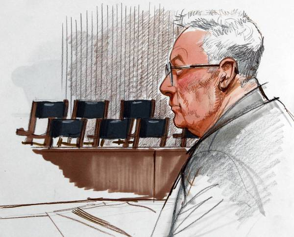 Drew Peterson listens to the proceedings during jury selection for his trial at the Will County Courthouse in Joliet.