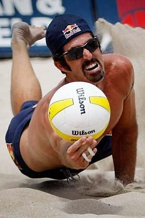 Todd Rogers dives for a dig during his and partner Phil Dalhausser's victory over John Hyden and Sean Scott during the men's finals of the AVP Crocs Slam Bud Light Hermosa Beach Open volleyball tournament.