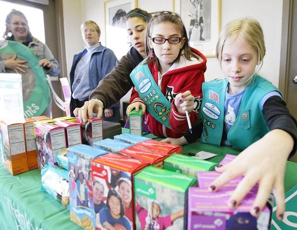 Girl Scouts Zoe Bankes-Largent (from right), Courtney Stoudt and Alessandri Figueroa sell Girl Scout cookies in Allentown in January, the start of the organization's 100th annivesary.