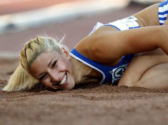 Greece's Voula Papachristou lands in the sand after her triple jump at the European Athletics Championships on June 29.