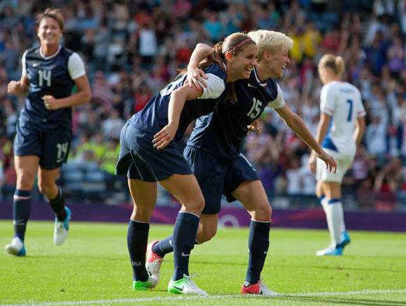United States' Megan Rapinoe, right and Alex Morgan celebrate together after Morgan scores her second goal.