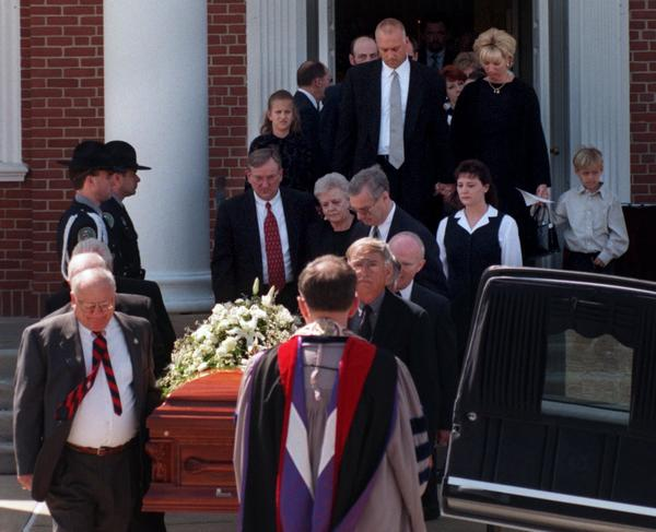 After the funeral service for Cal Ripken Sr. in 1999, Ripken family members and friends follow behind the casket as Cal Ripken Sr. is loaded into the hearse for the trip to cemetery.