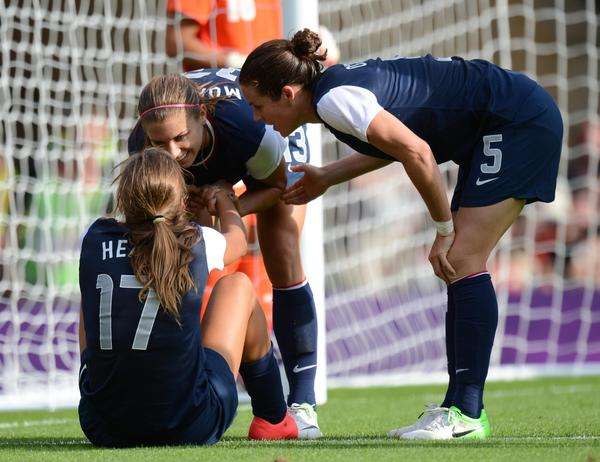 USA forward Alex Morgan (13) celebrates with midfielder Tobin Heath (17) and defense Kelley O'Hara (5) after scoring a goal against France during the women's preliminary match before the London 2012 Olympic Games at Hampden Park. USA won the match 4-2.