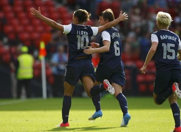 Carli Lloyd of the U.S. celebrates with team mates Amy LePeilbet (C) and Megan Rapinoe (R) after scoring against France during their women's Group G football match at the London 2012 Olympic Games at Hampden Park in Glasgow, Scotland July 25, 2012.