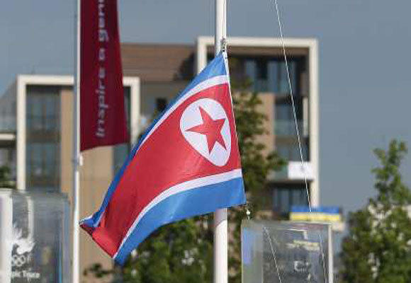 The North Korean flag is raised during the Olympic Team Welcome Ceremony at the Athletes' Village on July 25.