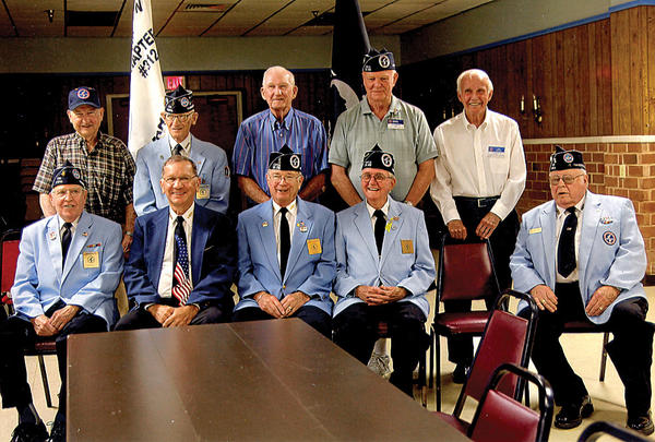 Those pictured are, seated, Jim Mobley, treasurer; Ron Twenty, second vice commander; Les Bishop, commander; Pat Patterson, vice commander; and Dr. Bud Johns, chaplain. Standing, Clayton Burkholder, historian; John Koontz Sr., executive committee representative; Carl Paylor, judge advocate; Charlie Morris, secretary; and Dick Sayles, sergeant-at-arms.
