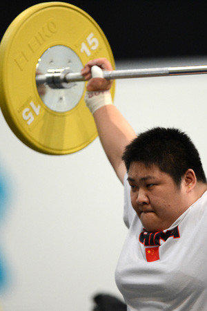 Zhou Lulu of China lifts during a weightlifting training session at the Excel centre ahead of the 2012 London Olympic Games on July 25, 2012. AFP PHOTO / TOSHIFUMI KITAMURATOSHIFUMI KITAMURA/AFP/