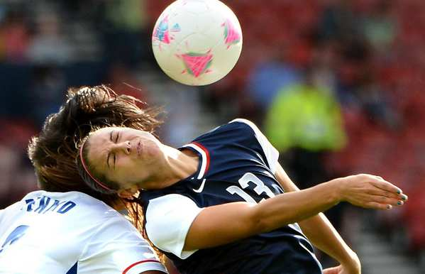 U.S. forward Alex Morgan, right, goes up for a header against France's Wendy Renard.