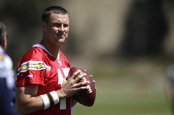 This May 29, 2012 file photo shows San Diego Chargers quarterback Philip Rivers warming up during NFL football training in San Diego. The Chargers have missed the postseason for two straight seasons and have one playoff win in the last four years. (AP Photo/Gregory Bull, File)