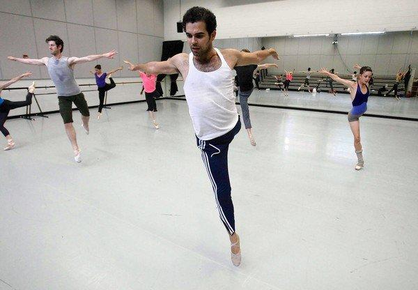 Dancer Orlando Canova, center, of Ballet Austin, practices new dance moves under the direction of Darrell Moultrie, a freelance choreographer from New York City.