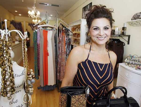 Anie Guluzian, owner of Posh Accessories, in her soon-to-close La Canada Flintridge store. Guluzian has been in the city for six years and is moving to San Marino where she has been open for one year.