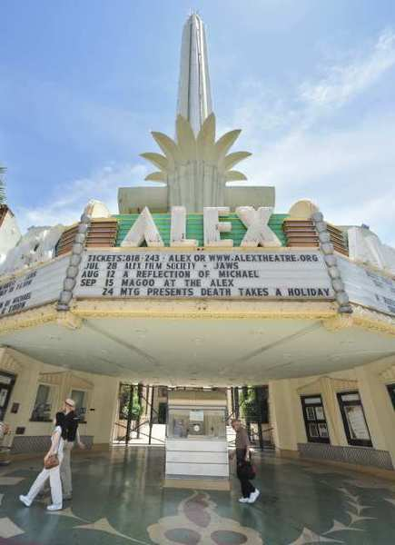 Pedestrians walk past the Alex Theatre. The City Council approved a zone change designating the venue as a civic building.