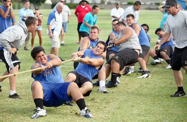 Members of the Fountain Valley High football team compete against Huntington Beach High in a tug of war match on Wednesday.