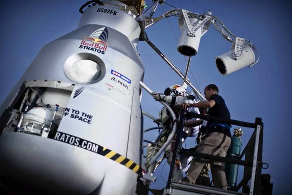 Daredevil Felix Baumgartner steps into a capsule from which he later jumped at 96,640 feet above Earth as part of a mission to break the world record.