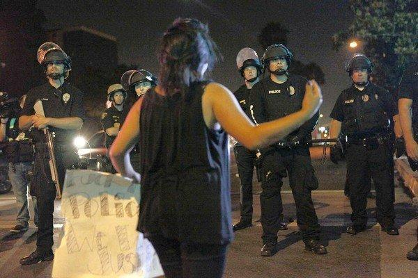Daisy Gonzalez, 16, the niece of Manuel Angel Diaz, who was killed Saturday, confronts police during a night of protest in Anaheim that turned violent.
