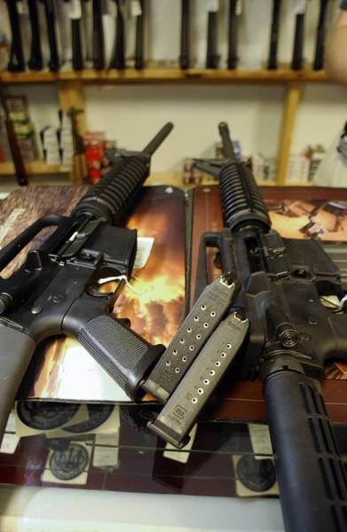 The AR-15 at right was once banned for its bayonet mount, flash suppressor and collapsible stock. The never-banned AR-15 at left is no less lethal.