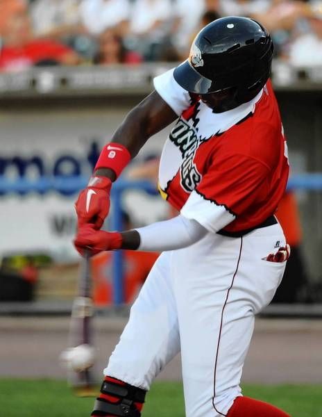 "IronPigs' #9 Domonic Brown at the plate against the Norfolk Tides Wednesday night in a ""Christmas in July"" themed game at Coca-Cola Park in Allentown."