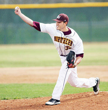 Northern State University's Clint Manzo delivers a pitch during Friday's first game against Winona State University at Fossum Field. photo by john davis taken 4/6/2012