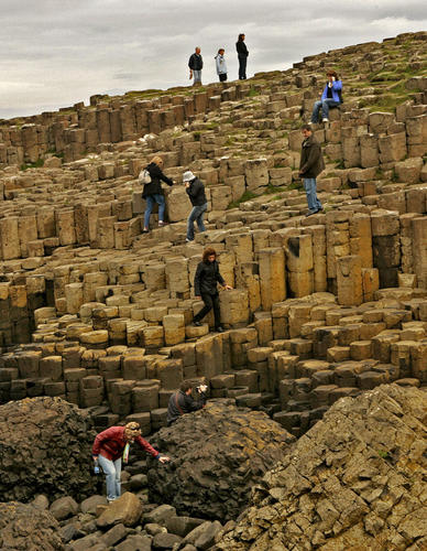 "The Giant's Causeway, at the foot of basalt cliffs in Northern Ireland, is made up of 40,000 black basalt columns jutting out of the ocean. Volcanic activity 50 million to 60 million years ago created these step-like columns on the edge of the Antrim plateau.<br /><br />  The tops of the causeway columns form ""stepping stones"" that lead from the foot of the cliff and disappear under the sea. Legend has it that the mythical hunter-warrior Fionn mac Cumhaill (Finn McCool) built the causeway to aid in the fight against Benandonner, his Scottish counterpart.<br /><br />  -- Kelsey Ramos"