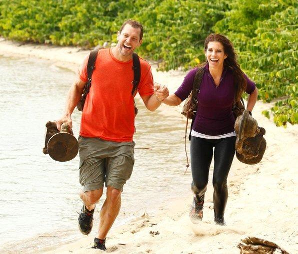 """Love in the Wild"" contestants Ken Barrington (left) and Yanina Beccaria (right) make their way to the finish line in the show's season finale."