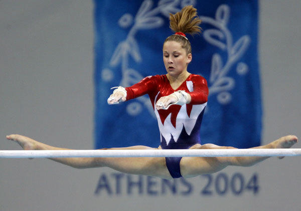 Carly Patterson of the U.S. performs a routine on the asymmetric bars during the women's artistic gymnastics qualifying session at the Athens 2004 Olympic Summer Games August 15, 2004.