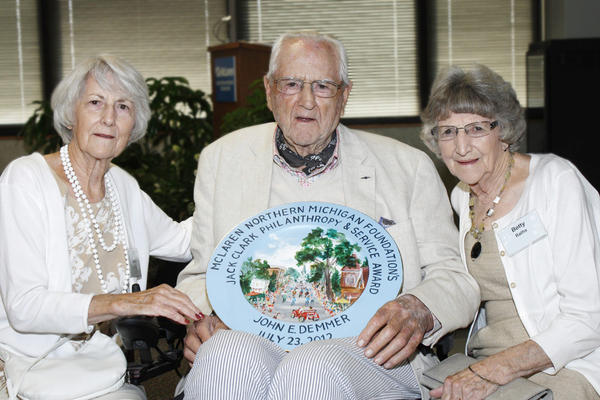 John Demmer holds the Jack Clark Philanthropy and Service Award, which he received for his contributions to the health system for nearly 30 years. He is seen here with his sisters, Dodie Beetham (left) and Betty Raths (right).
