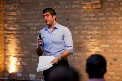 STAND UP Co-Founder Anthony Navarro delivers a speech at the Townhall Meeting launch of STAND UP, Business Professionals for Marriage Equality on Tuesday, July 24.