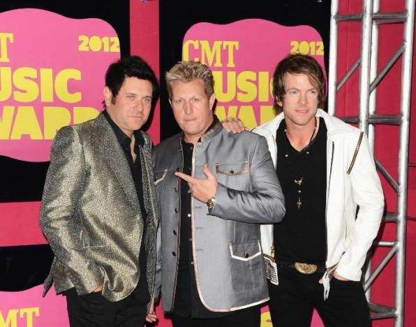 (L to R) Jay DeMarcus, Gary LeVox and Joe Don Rooney of Rascal Flatts arrive at the 2012 CMT Music awards at the Bridgestone Arena on June 6, 2012 in Nashville, Tennessee.