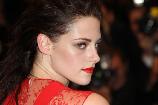 "Kristen Stewart poses as she arrives for the screening of ""Cosmopolis"" presented in competition at the 65th Cannes film festival on May 25, 2012 in Cannes."