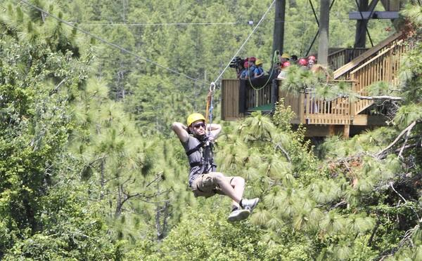 Gatorland has installed a zipline over the park. It runs among seven towers, some of it over the alligator ponds. It was constructed by Global Highline Adventures. Here, staff member Carlos Hernandez tests out the longest run.