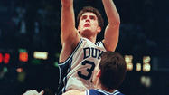 He was the official who ruled that Christian Laettner's overtime shot beat the final buzzer to cost Kentucky a Final Four berth, but few people know that Tom Clark had actually grown up a Kentucky fan.