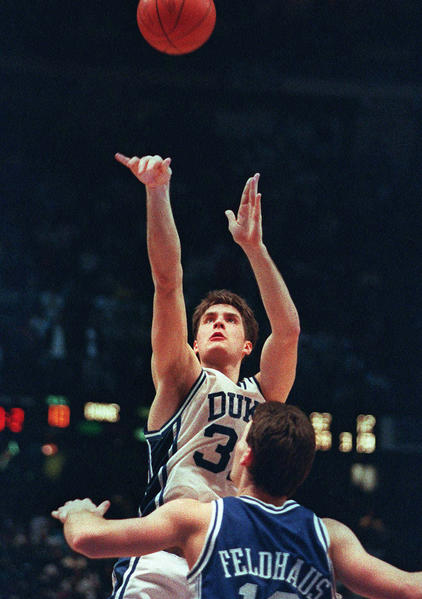 Christian Laettner of Duke shoots the game-winning shot over Kentucky's Deron Feldhaus to give the Blue Devils a 104-103 win in the 1992 NCAA East Regional final. Former official Tom Clark worked that game, ruling that Laettner's shot beat the buzzer.