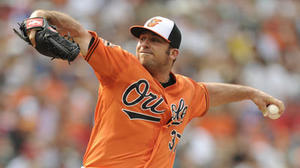 O's purchase left-hander Dana Eveland's contract, option infielder Steve Tolleson to Norfolk