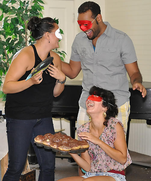 """Bay View Music Festival singers (from left) Tasha Koontz, Miguel Vasquez and Noelle Harb rehearse the comedic drama """"Don Giovanni."""""""