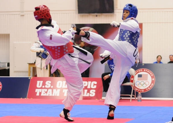 Paige McPherson, right, lands a kick against her opponent Nia Abdallah, of Houston, Texas, at the 2012 Olympic Trials Finals for taekwondo, March 10, in Colorado Springs, Colo. McPherson won 5-4 to secure a spot on the USA taekwondo Olympic team that will be competing in the 2012 Summer Olympic Games, in London.